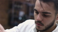 Portrait of stylish barber. Professional filmed on video, while working in his Stock Footage