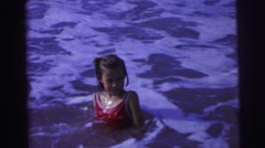 1967: young white girl swimming in ocean beach water foamy frothy waters BRAZIL Stock Footage