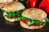 Close-up of home made tasty burgers on wooden table Stock Photos