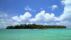 Paradise Island Palm trees in tropical aquamarine lagoon a luxury vacation Stock Footage