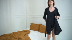 Female model posing in home dress in bedroom slow motion Stock Footage