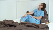 Attractive woman in pyjama sitting in bed slow motion Stock Footage