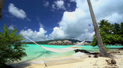 Beach hammock Overwater Bungalows in tropical aquamarine lagoon a luxury Stock Footage