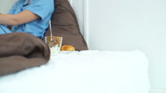 Beautiful woman wearing pyjama going to have breakfast in bed Stock Footage
