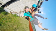 Jump in tandem with selfie Stock Footage