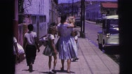 1967: single mother with gaggle of children walking some sidewalk BRAZIL Stock Footage