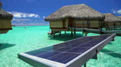 Overwater luxury Bungalows powered by solar energy in Aquamarine lagoon a Stock Footage