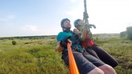 After the jump tandem hanging on a clothesline selfy Stock Footage