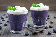 Healthy boiled egg blueberry mousse in glass, horizontal Stock Photos
