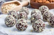 Healthy homemade paleo chocolate energy balls on parchment, horizontal Stock Photos
