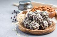 Healthy homemade paleo chocolate energy balls, horizontal, copy space Stock Photos