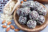 Healthy homemade paleo chocolate energy balls on wooden plate, horizontal Stock Photos