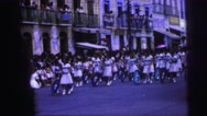 1967: parade of women pushing bicycles with blue wheels on street BRAZIL Stock Footage