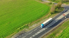 Camera follows white truck, on the road. Aerial footage. Autumn landscape. Stock Footage