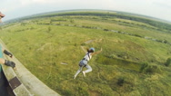 Girl jumping with the help of an instructor Stock Footage