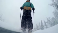 Young skier slides down the slope Stock Footage