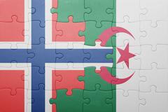 Puzzle with the national flag of algeria and norway Stock Photos