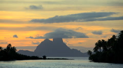 View at sunset of tropical Bora Bora Island lagoon and Mt Otemanu mountain in Stock Footage