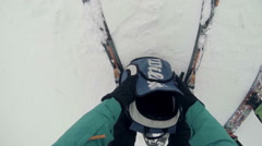 Skier prepares to move down the slope Stock Footage
