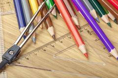 Coloring pencils on a desk with a set square Stock Photos