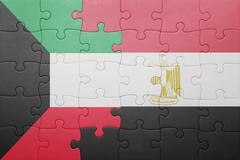 Puzzle with the national flag of kuwait and egypt. Stock Photos