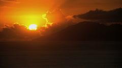 Sunset over the mountain paradise of a luxury vacation resort on Bora Bora Stock Footage