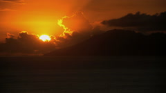 Sunset over remote Mt Otemanu and a tropical lagoon by the luxury vacation Stock Footage