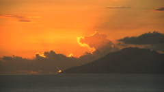 Sunset time lapse over remote Mt Otemanu and a tropical lagoon by the luxury Stock Footage