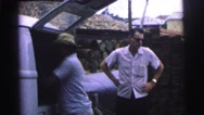 1967: man unloading boxes of supplies from delivery truck BRAZIL Stock Footage