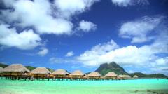 Mt Otemanu Overwater luxury Bungalows in tropical Aquamarine lagoon a Tahitian Stock Footage