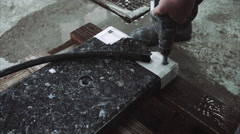 Worker drill hole in stone plate Stock Footage