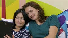 Two Sisters Are Watching Funny Photos Stock Footage