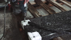 Drilling a hole in stone Stock Footage