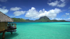 Mt Otemanu and overwater bungalows in a luxury tropical Tahitian vacation resort Stock Footage