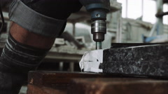 Worker makes the holes in the marble plate, close up Stock Footage