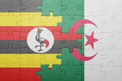 Puzzle with the national flag of algeria and uganda Stock Photos