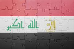Puzzle with the national flag of iraq and egypt. Kuvituskuvat