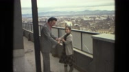 1978: handshaking on the top of building with view of city ITALY Stock Footage