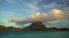 Sunset lagoon Mt Otemanu mountain in tropical Tahitian vacation resort of Bora Stock Footage