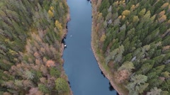 Aerial view flying over river with autumn forest Stock Footage