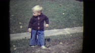 1946: young boy backs up into front yard DETROIT, MICHIGAN Stock Footage