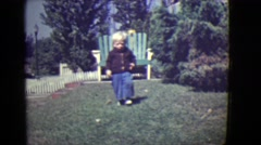 1946: cute blonde kid running summer perfect weather fun day DETROIT, MICHIGAN Stock Footage