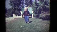 1946: cute blonde kid running summer perfect weather fun day DETROIT, MICHIGAN Stock Footage