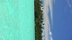 Vertical view of luxury peaceful Paradise Island aquamarine sea coral Reef Bora Stock Footage