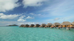 Time lapse view of aquamarine lagoon Overwater luxury Bungalows in tropical Stock Footage
