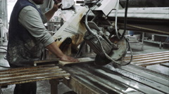 Worker uses saw machine for cutting marble stone piece Stock Footage