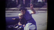 1946: mom and sons are saying hi DETROIT, MICHIGAN Stock Footage