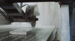 Saw machine makes a cross-section on the marble stone plate Stock Footage