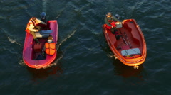 Paris, France. Overhead shot of men in motor boats talking to each other. Stock Footage