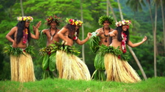 Young males and females in a group of Tahitian hula dancers performing outdoor Stock Footage